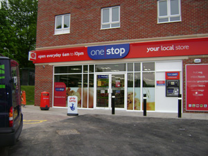 Tesco's One Stop achieves store target by buying Mills Group