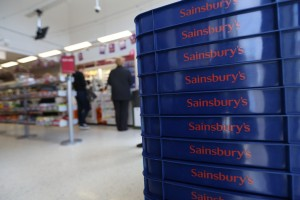 Sainsbury's reports first full-year loss in a decade