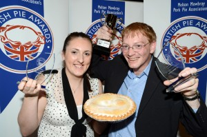 Catherine Simpson and Graham Amison of Morecambe FC with their winning trophies and award winning pie