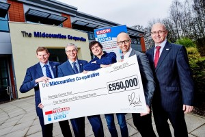 L-r: Pete Westall, Ben Reid (both Midcounties Co-operative), Ben Irving, a Teenage Cancer Trust ambassador, Tom Marshall, head of partnership fundraising at Teenage Cancer Trust, and Adrian Wilkinson, group general manager for The Midcounties Co-operative Pharmacy