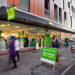 Morrisons to close 11 supermarkets as profits slide in first half