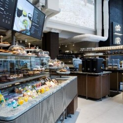 Starbucks removes queues at tills and offers customer ordering from handheld devices in new flagship London store