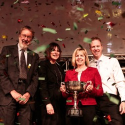 Spar Pentraeth's Jill and Paul Lewis proudly take Blakemore Trade Partners' Baldwin Trophy