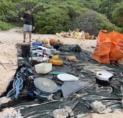 Expedition to world's most polluted beach battles adverse conditions to bag six tonnes of waste