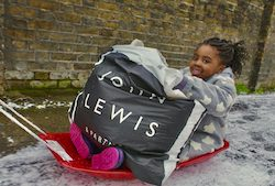 John Lewis donates warm clothing to thousands of families during the UK's cold spell